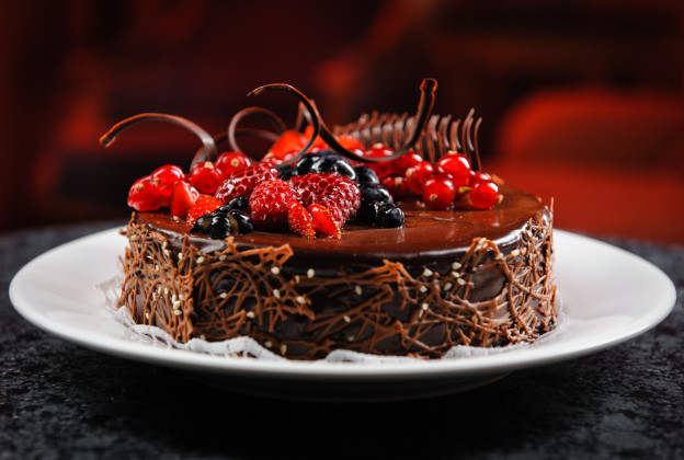 Luscious chocolate cake with fresh berries on a plate