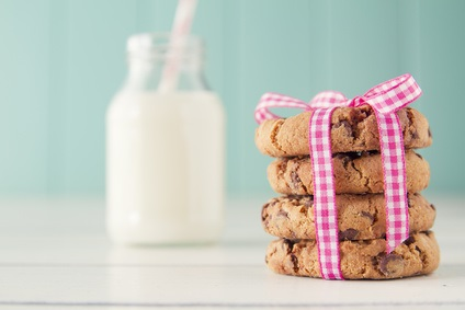 Chocolate chip cookies and a school milk bottle with a straw.