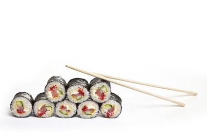 sushi with chopsticks on a white background
