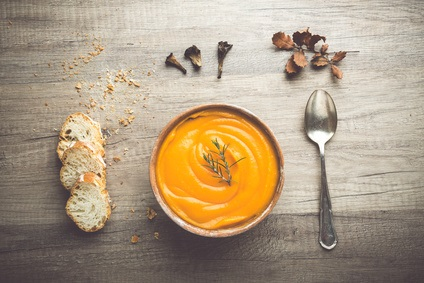 Pumpkin Soup prepared for autumn with chicken broth, spices and other vegetables
