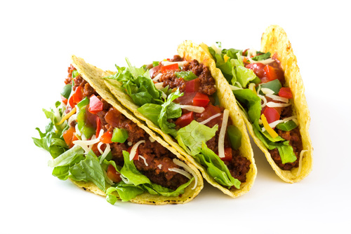 Traditional Mexican tacos with meat and vegetables, isolated on